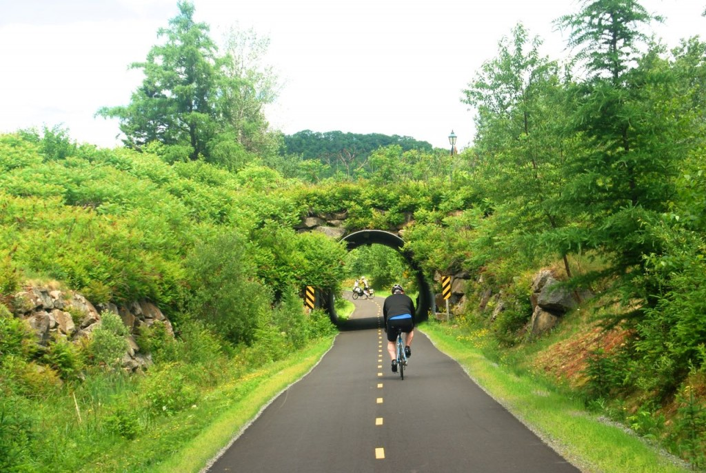 Cyclist on a paved portion of the trail