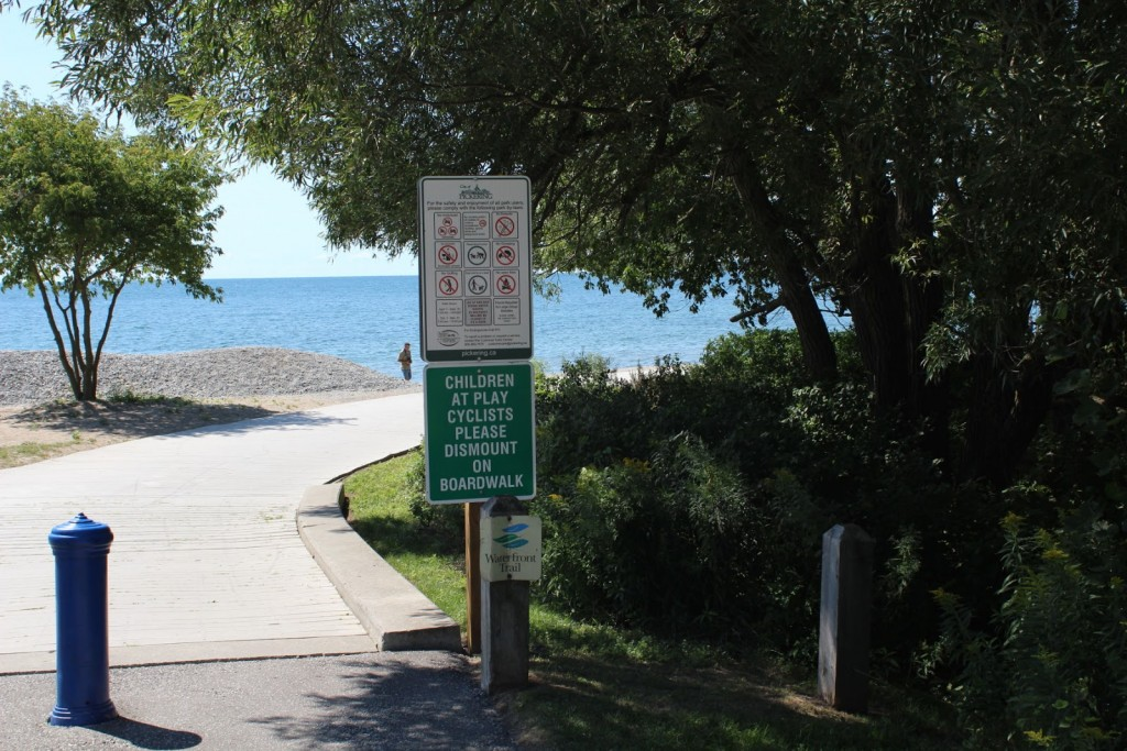 "A ""Cyclists Dismount"" sign placed near Frenchman's Bay Marina"